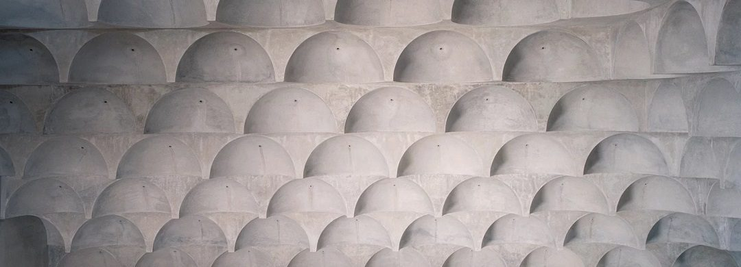 102 quarter-spherical concrete domes adorn punchbowl mosque by candalepas associates