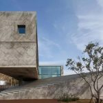 Concrete house appears to float over its base