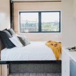 Compact Tiny House Makes Space for Four with Novel Pull-Down Bed