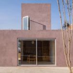 This Pink Concrete Home is an Affordable Housing Prototype