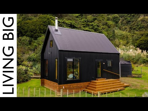 Stunning Black Off-Grid Cabin By The Rive