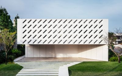 Diagonal Slits Pierce White Shutters Wrapping Casa Ventura by Arquitetura Nacional