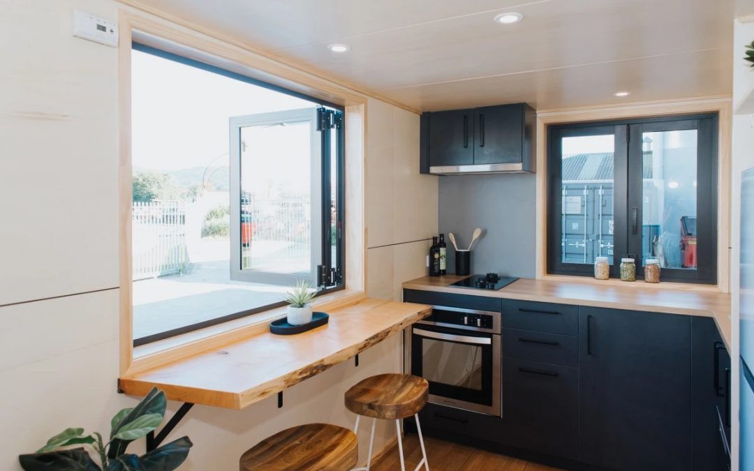 This Compant House Focuses on Storage Space and Large Kitchen Area