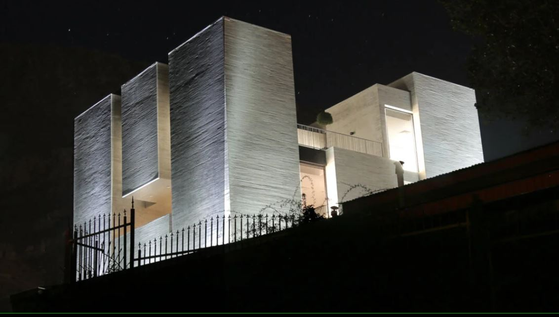 iranian studio MAAN sculpts its monolithic 'ayenevarzan house' of solids and voids